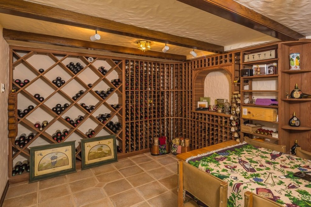 The wine cellar offers stylish racks that can hold up to hundreds of bottles. Images courtesy of Toptenrealestatedeals.com.