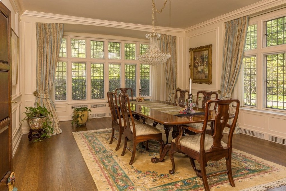 Formal dining room featuring a classy dining table and chairs set on top of an elegant area rug. Images courtesy of Toptenrealestatedeals.com.