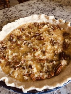 The finished filling is placed on the unbaked crust.