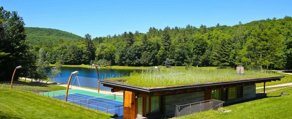 This is the tennis court of the property just beside the large lake. Here you can also see that there is a small two-story wooden house beside it adorned with grass on its roof. Image courtesy of Toptenrealestatedeals.com.