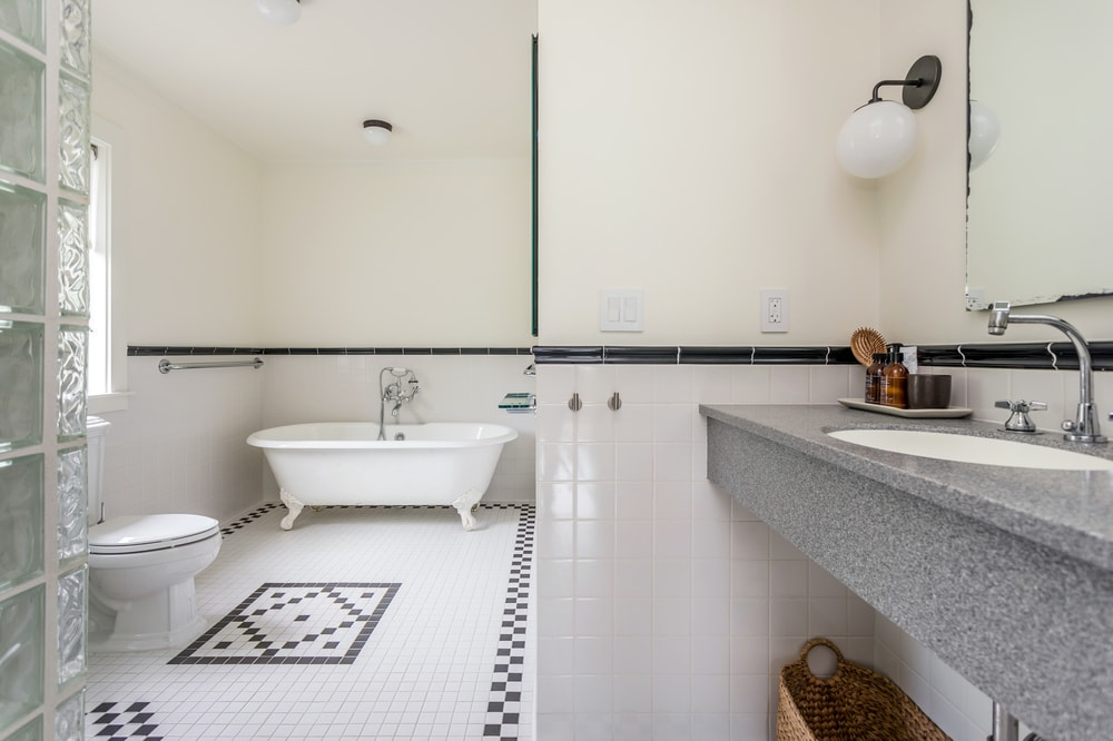 This is a look at the bathroom with a floating vanity and a large bathing area on the far side. Image courtesy of Toptenrealestatedeals.com.