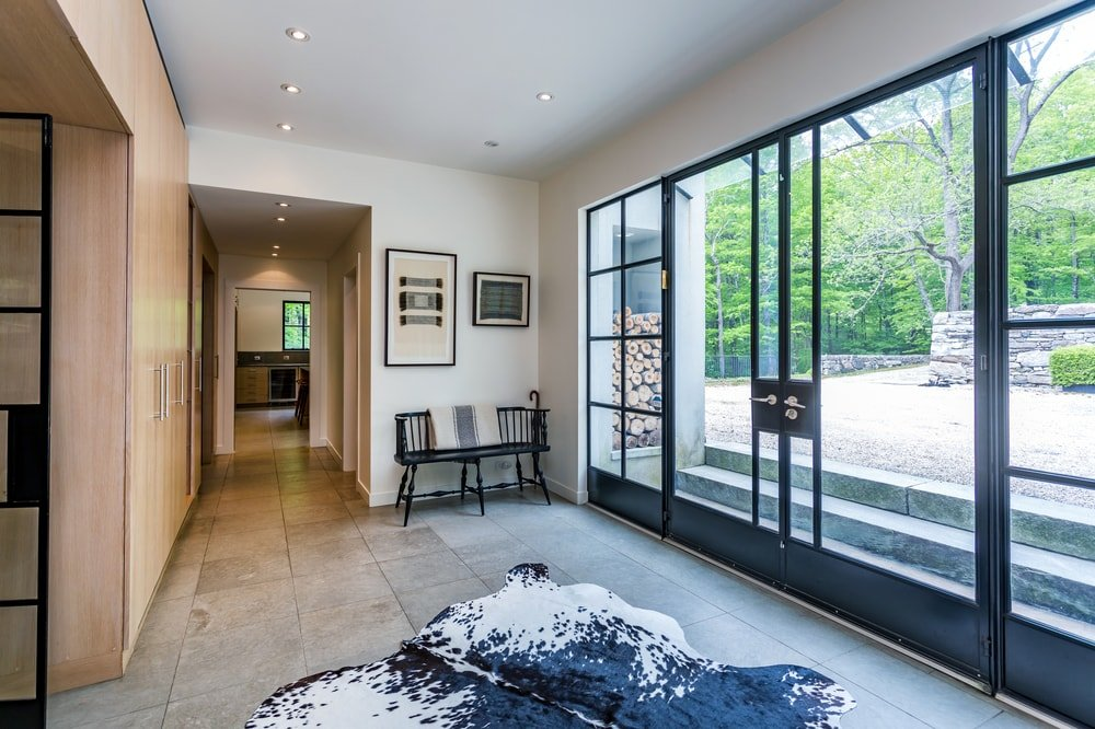 Upon entry of the house, you are welcomed by this foyer that is brightened by the pair of glass doors and the glass sidelights. Image courtesy of Toptenrealestatedeals.com.
