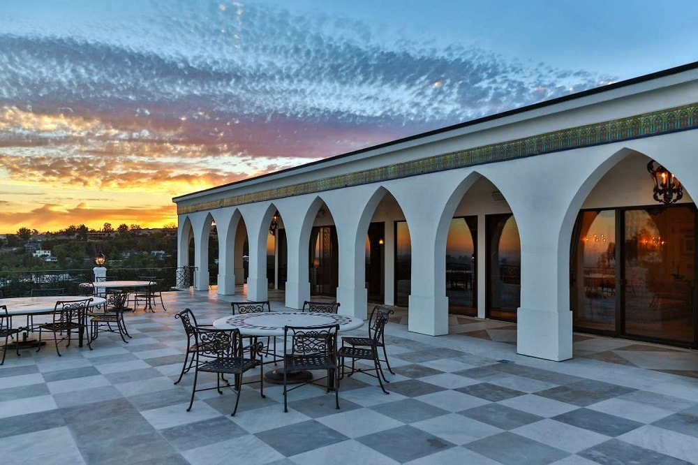 This is a look at the terrace area just outside the arches of the house. You can see here the checkered pattern of the flooring tiles that pair well with the arches of the house exterior. Image courtesy of Toptenrealestatedeals.com.