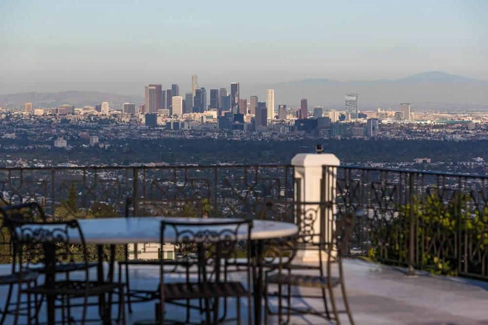 This is a look at the city views afforded by the terrace fitted with an outdoor dining area. Image courtesy of Toptenrealestatedeals.com.