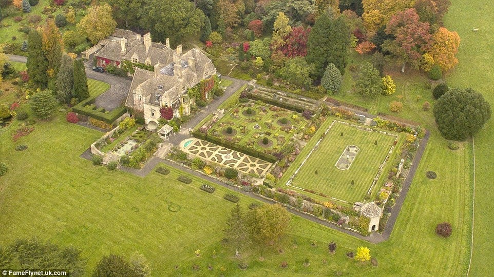 This aerial view of the property shows just how large the property is with its stone mansion, large lawns and gardens filled with shrubs and tall trees. Image courtesy of Toptenrealestatedeals.com.