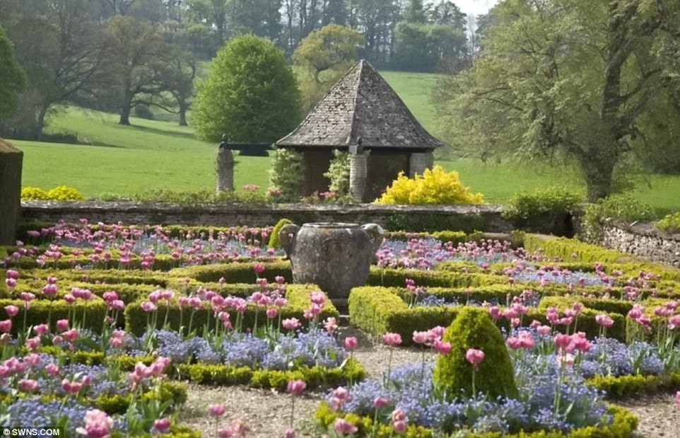 This is the flower garden with hundreds of colorful flowers bringing color and vibrancy to the green area. On the far side, is a stone hut with open walls adding a bit more character to the scenery. Image courtesy of Toptenrealestatedeals.com.