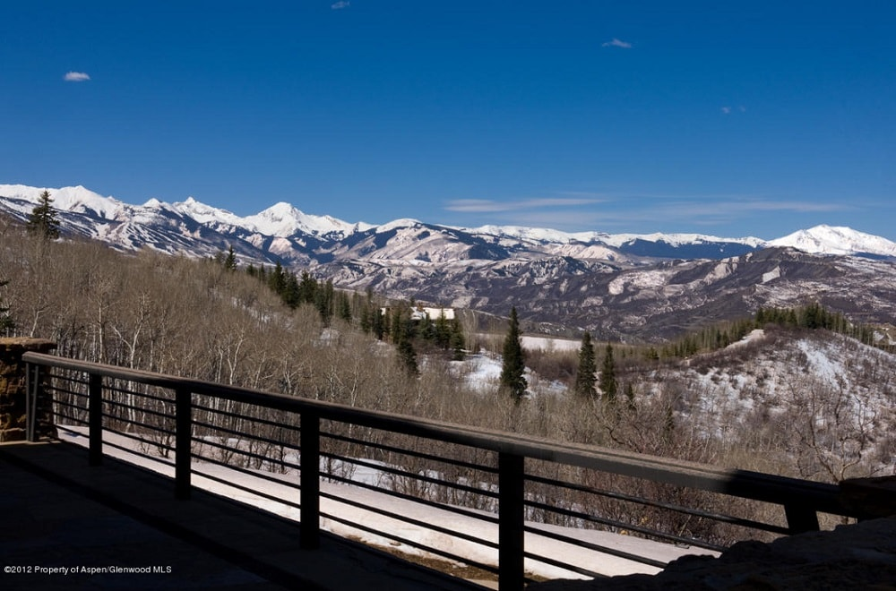 This is a view of the mountains from the vantage for the balcony. This is bordered with railings for safety. Image courtesy of Toptenrealestatedeals.com.