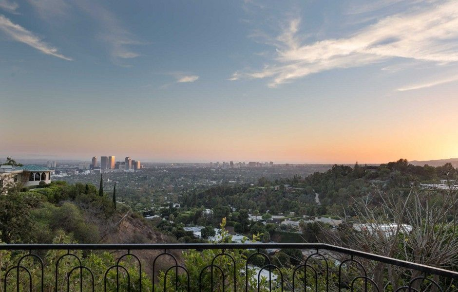 City view from the home's balcony area. Image courtesy of Toptenrealestatedeals.com.