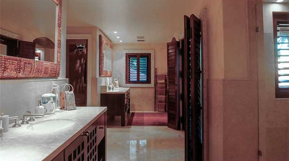Large bathroom with two sink counters and a walk-in shower room. Image courtesy of Toptenrealestatedeals.com.