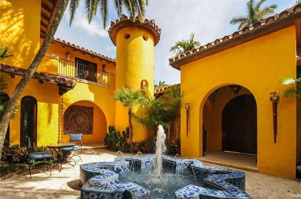 There's a fountain in the home's courtyard too, with a small table set on the side. Image courtesy of Toptenrealestatedeals.com.