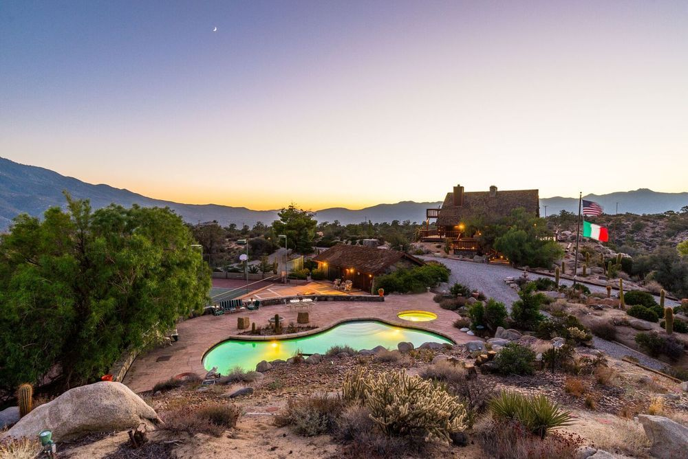 Aerial view of the property during sunset boasting the stunning surroundings. Image courtesy of Toptenrealestatedeals.com.