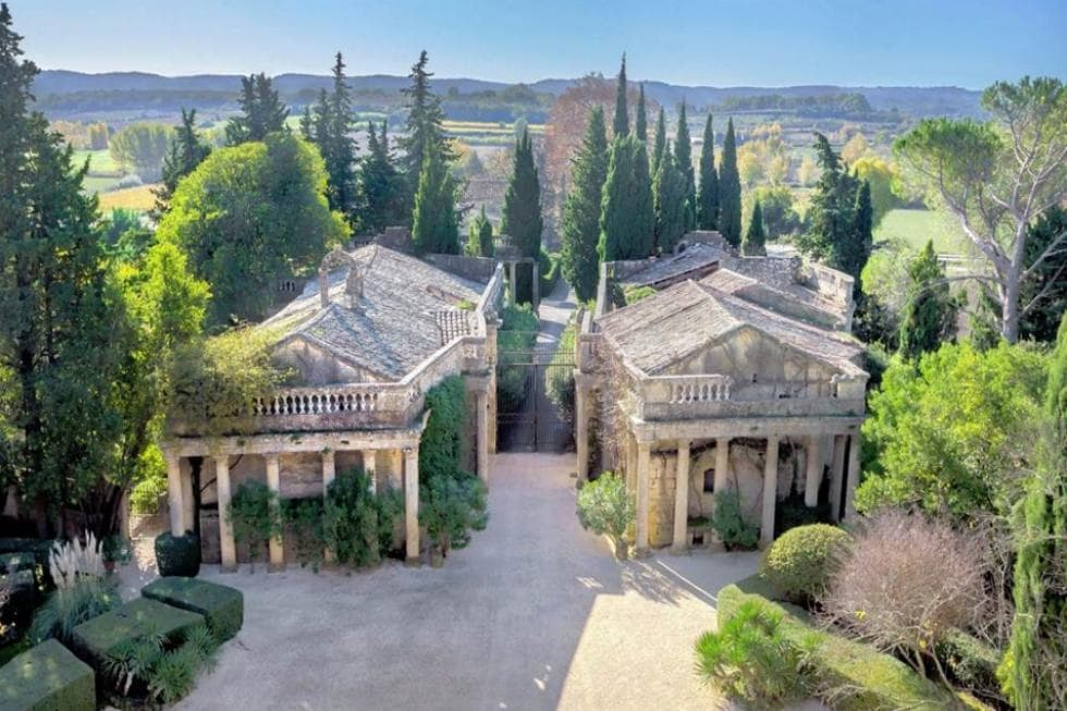 This is an aerial view of the back of the house. Here you can see more of those Greek-style pillars that give character to the house exteriors along with trees placed in between them. Image courtesy of Toptenrealestatedeals.com.
