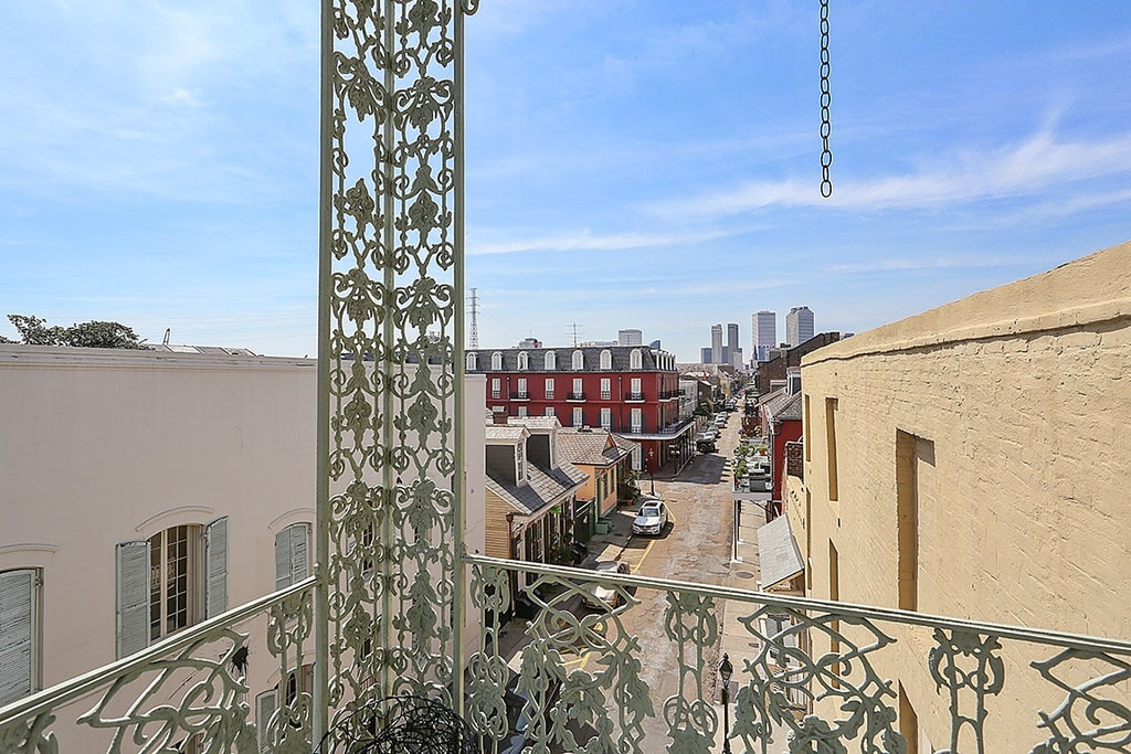 This is view from the balcony of the upper floors of the mansion. Here you can see the intricate design of the railings that extend to the support pillars. Image courtesy of Toptenrealestatedeals.com.