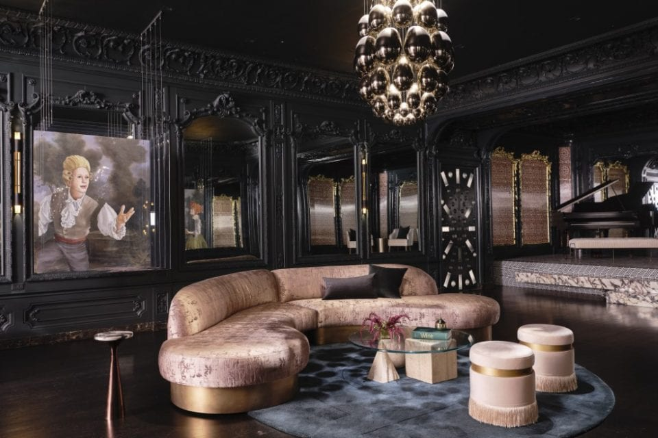 This is the nightclub with dark elegant walls, ceiling and floor to make the rose gold sofa set stand out under the large decorative lighting. Image courtesy of Toptenrealestatedeals.com.