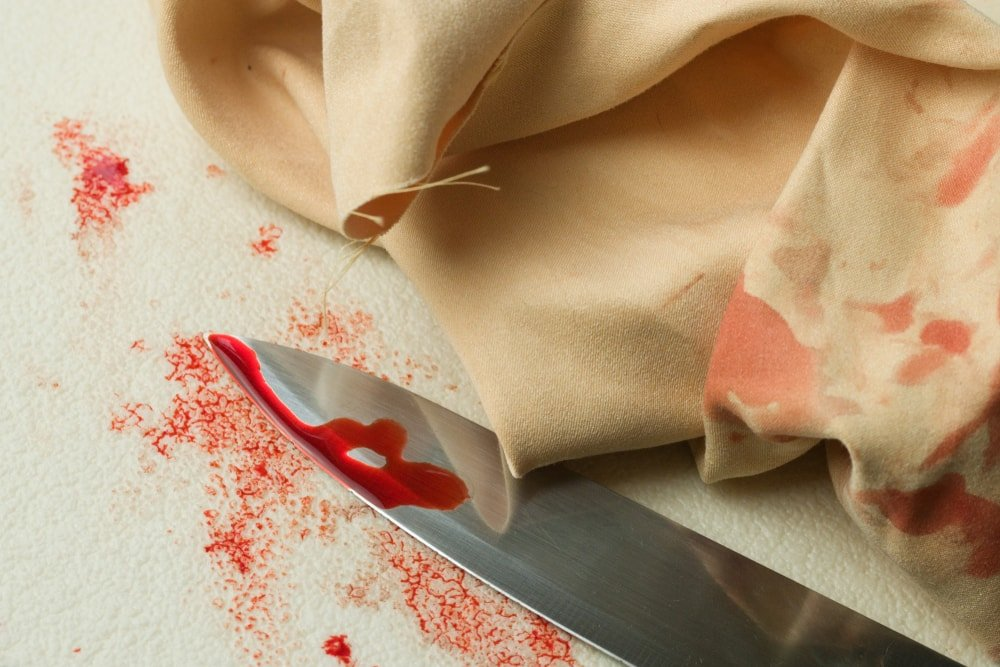 A bloody knife on the carpet.