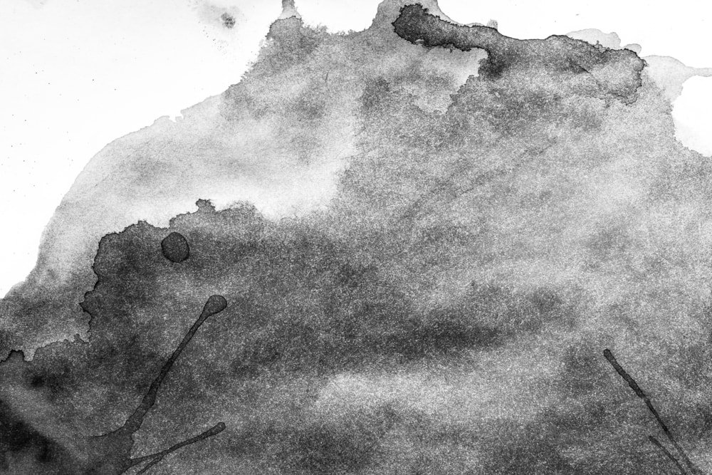 A close inspection of ink stains on a light surface.