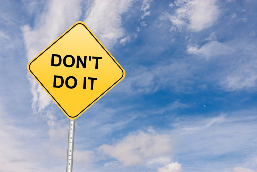 A road sign saying Don't do it.
