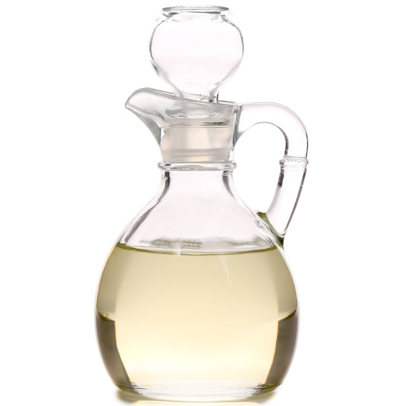 A glass bottle filled with vinegar.