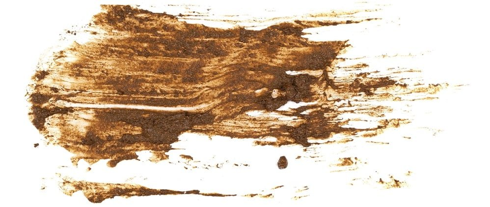 A smear of dried mud on a white surface.