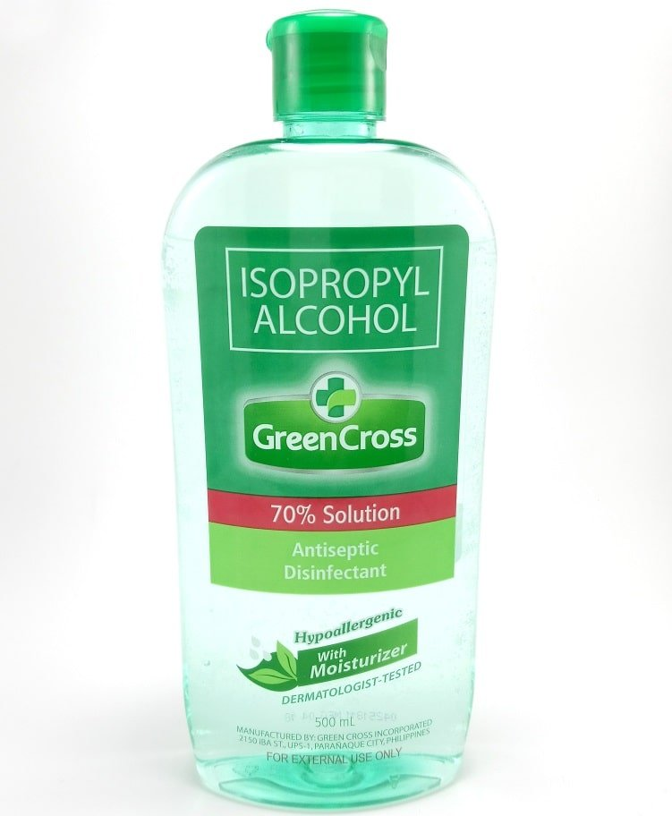A close look at a bottle of Green Cross brand isopropyl alcohol.