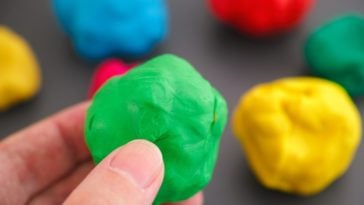 A close look at a piece of green playdough.