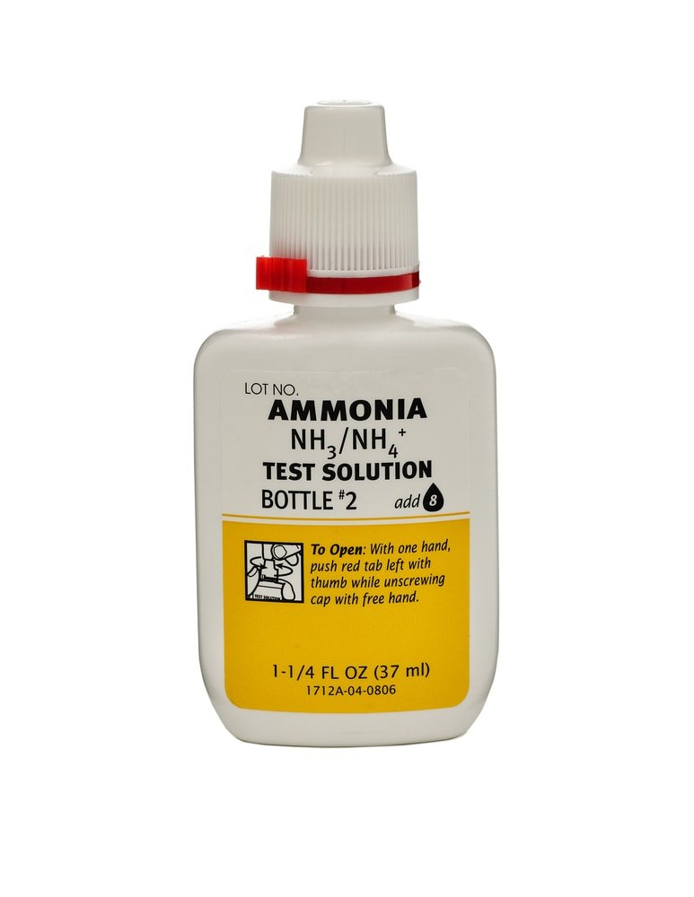 A small bottle of ammonia with child-proof lock.