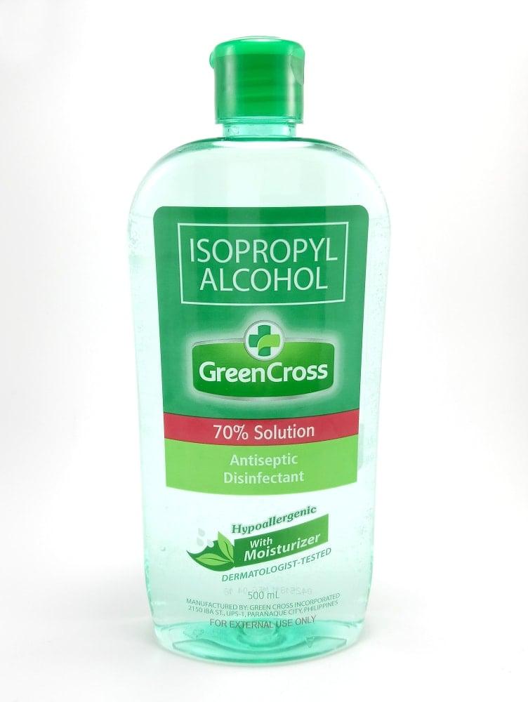 A bottle of Green Cross brand isopropyl alcohol.