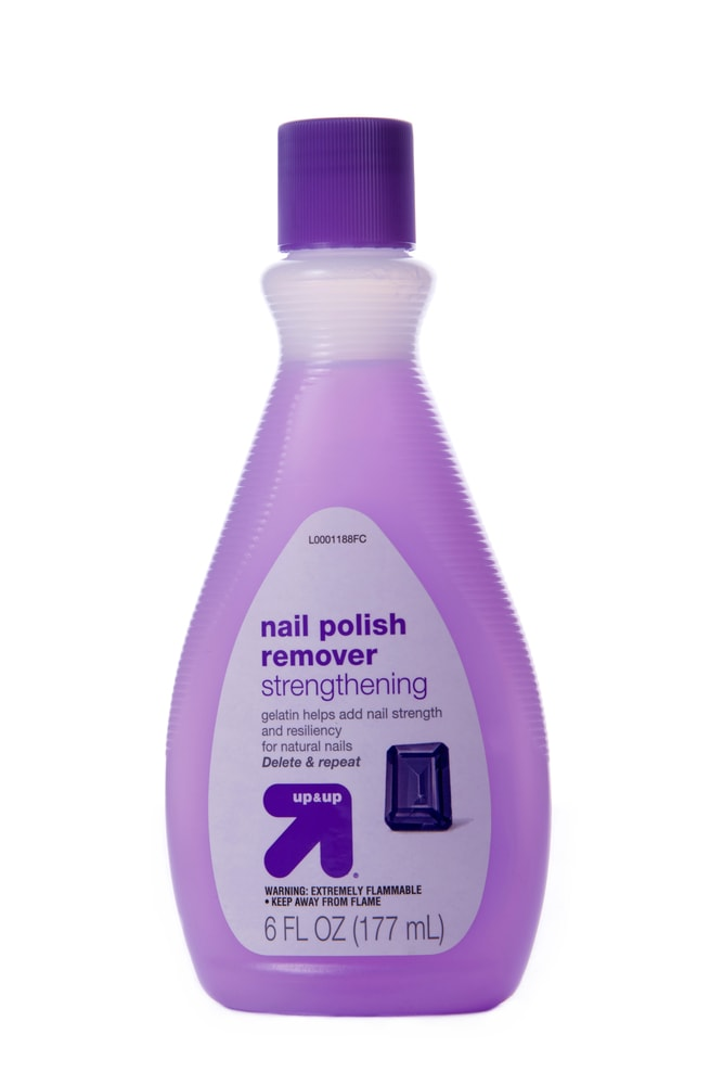 A small bottle of nail polish remover.