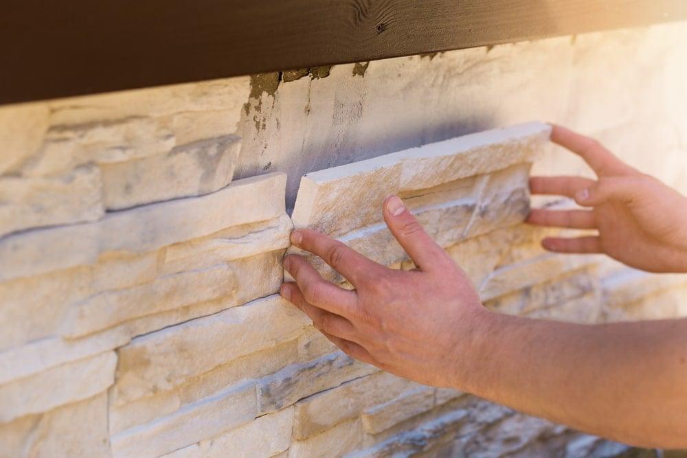Installing faux stone and brick veneer.