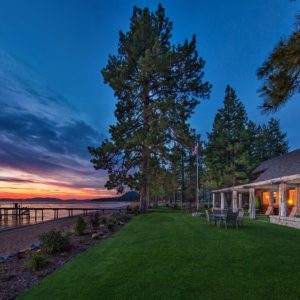 This is a view of the house showing its exterior that faces the lake. You can also see here a spacious grass lawn that separates the house from the lakeshore. Image courtesy of Toptenrealestatedeals.com.