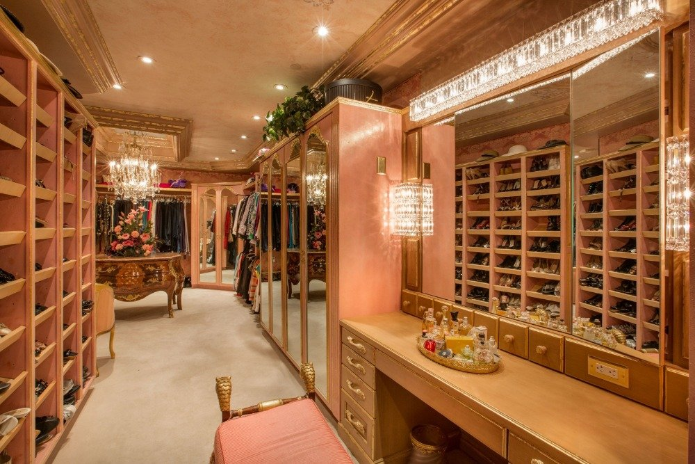 The large closet offers a large shoe rack and multiple cabinets along with a makeup desk. Images courtesy of Toptenrealestatedeals.com.