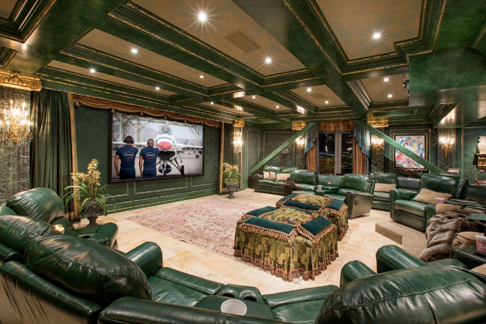 Large home theater with elegant green walls matching the green sectional seats. Images courtesy of Toptenrealestatedeals.com.