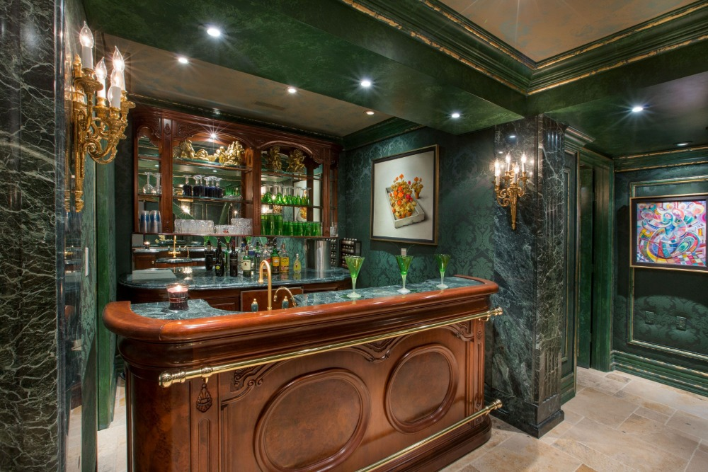 This bar offers a stylish counter and elegant green walls. Images courtesy of Toptenrealestatedeals.com.