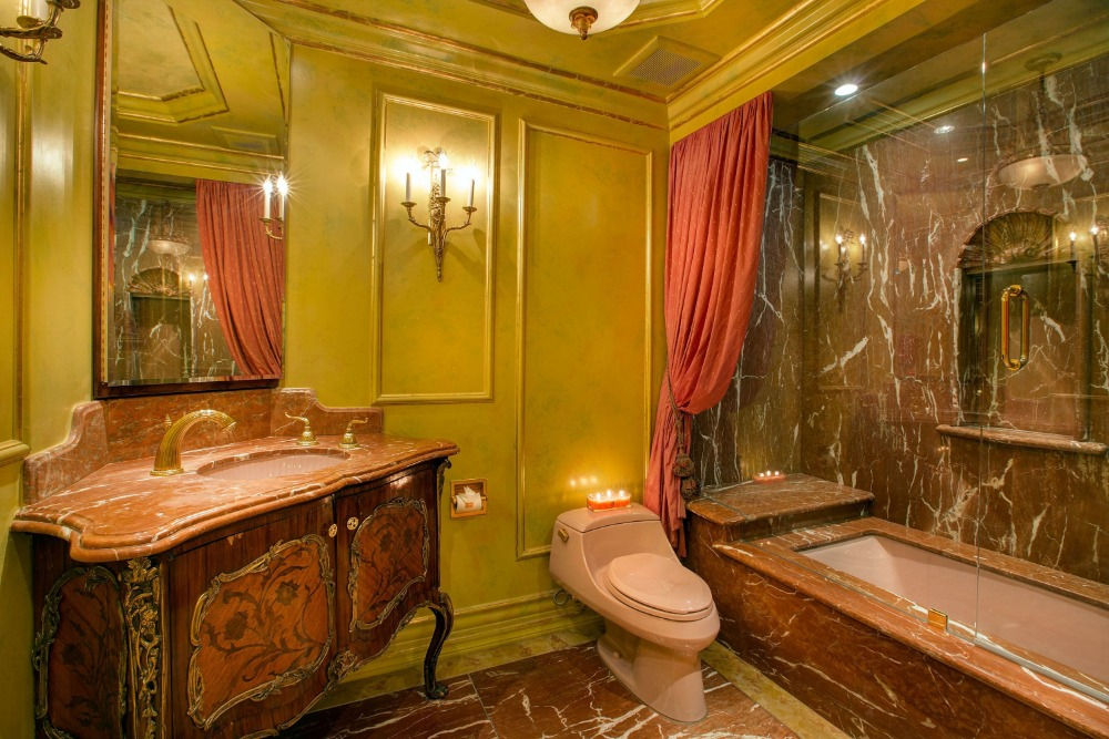 Another bathroom with an elegant sink counter and a bathtub and shower combo. Images courtesy of Toptenrealestatedeals.com.