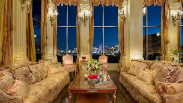 Focused look at the formal living's luxurious sofa set lighted by elegant wall lights. Images courtesy of Toptenrealestatedeals.com.