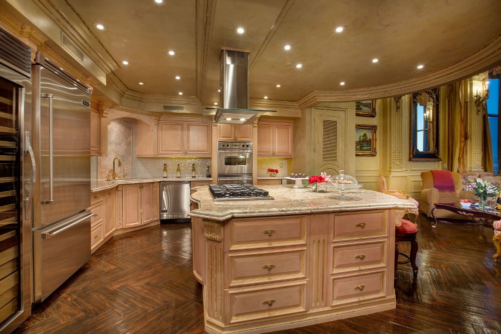 Large kitchen with a custom center island. The recessed ceiling lights look good with the area. Images courtesy of Toptenrealestatedeals.com.