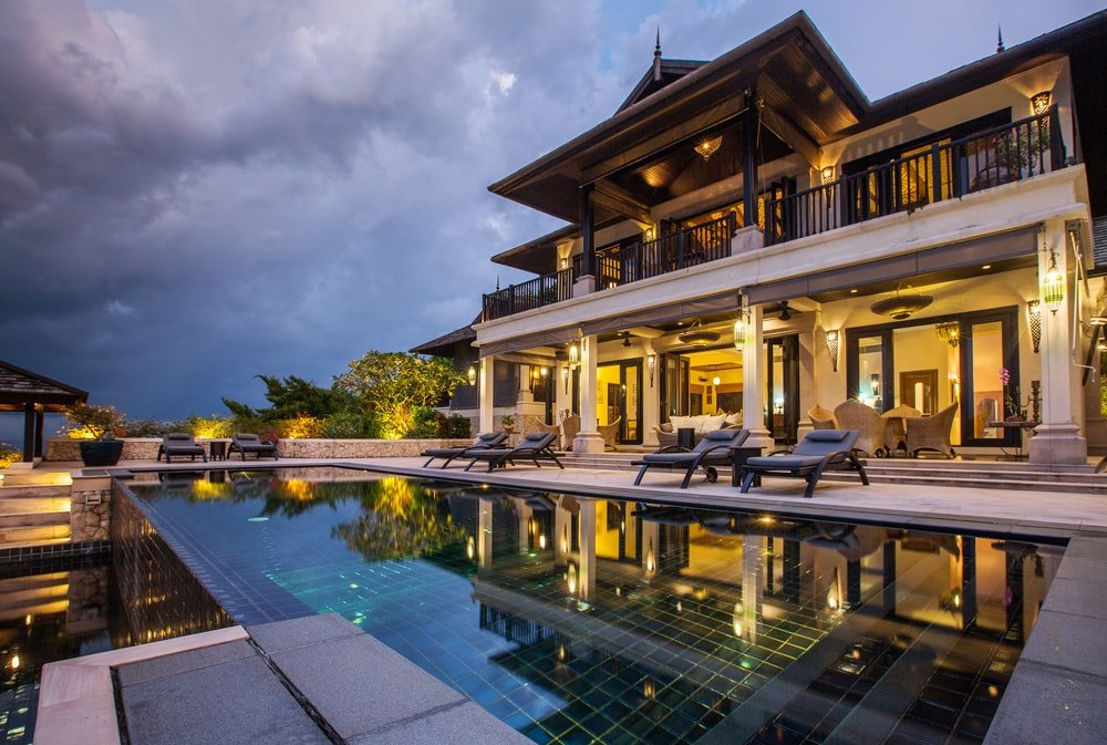 A luxury home facing an infinity pool.