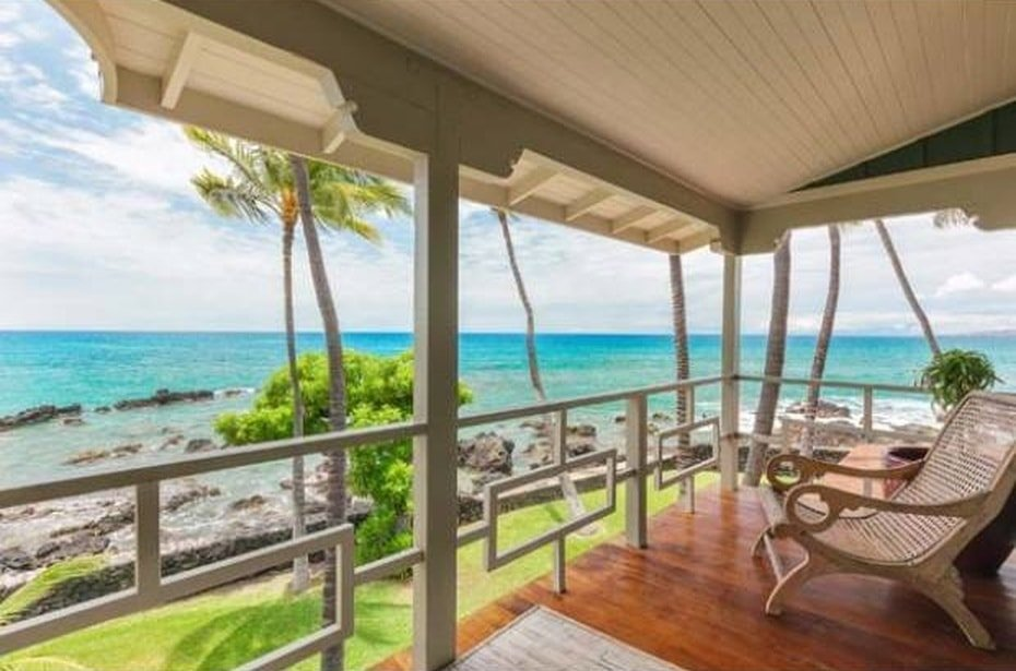 This is the balcony at the second level of the house. It has beige hues on its ceiling, pillars and railings to be complemented by the hardwood flooring and the view of the landscape. Image courtesy of Toptenrealestatedeals.com.