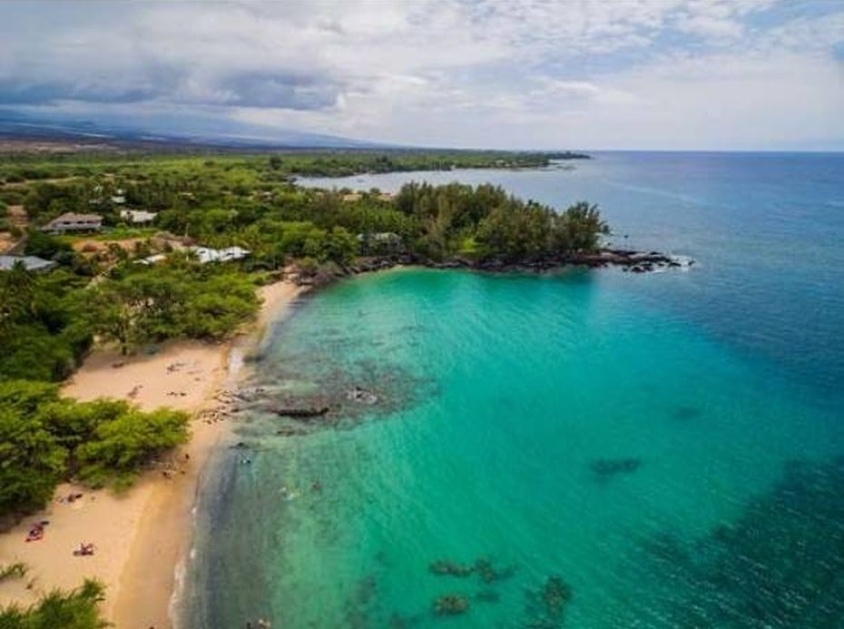 This is an aerial view of the beach area that comes with the property. It has clean sand and water. Image courtesy of Toptenrealestatedeals.com.