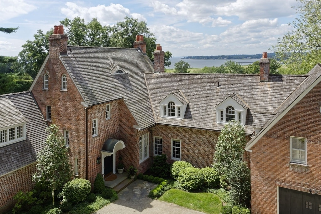 This is an aerial view of the front of the house showing its brick exterior walls, tall chimneys and dormer windows. You can also see here the main entrance of the house. Image courtesy of Toptenrealestatedeals.com.
