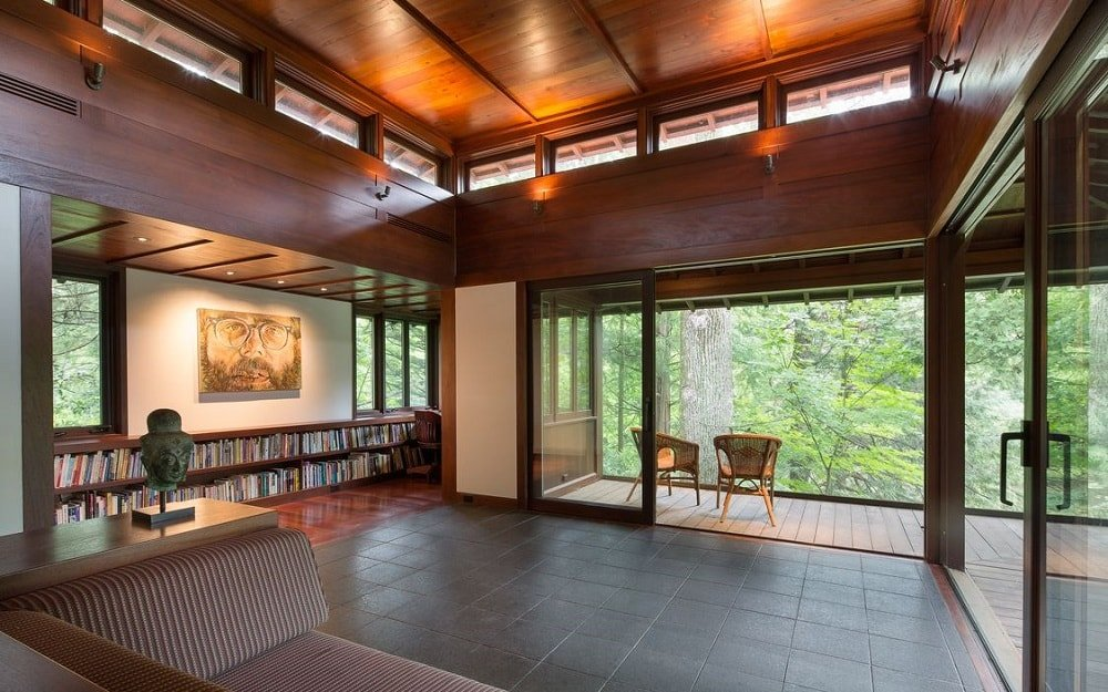 Here you can see the large open area in front of the living room leading to the balcony on the far side through glass doors and to the library on the left side. Image courtesy of Toptenrealestatedeals.com.