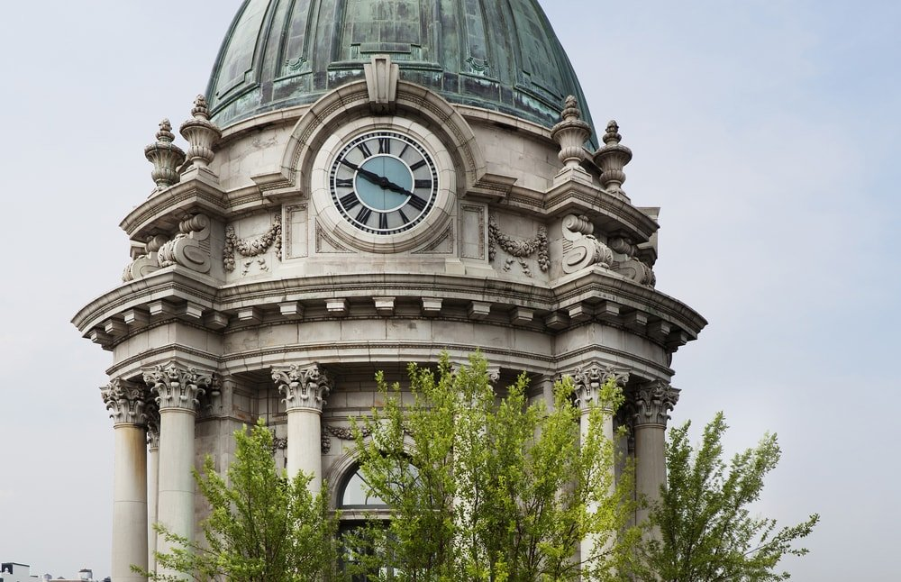 This is a look at the tall dome of the penthouse. You can see here that it has intricate details that give it character along with tall pillars and a large clock. Image courtesy of Toptenrealestatedeals.com.
