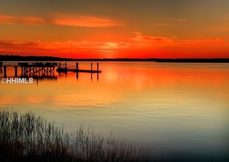This is a view of the sunset from the property. Here you can also see the deep water dock of the property. Image courtesy of Toptenrealestatedeals.com.
