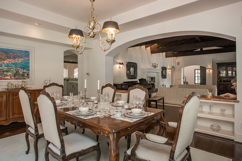 Another view at the home's dining area with its elegant dining table set lighted by stunning ceiling lighting. Image courtesy of Toptenrealestatedeals.com.