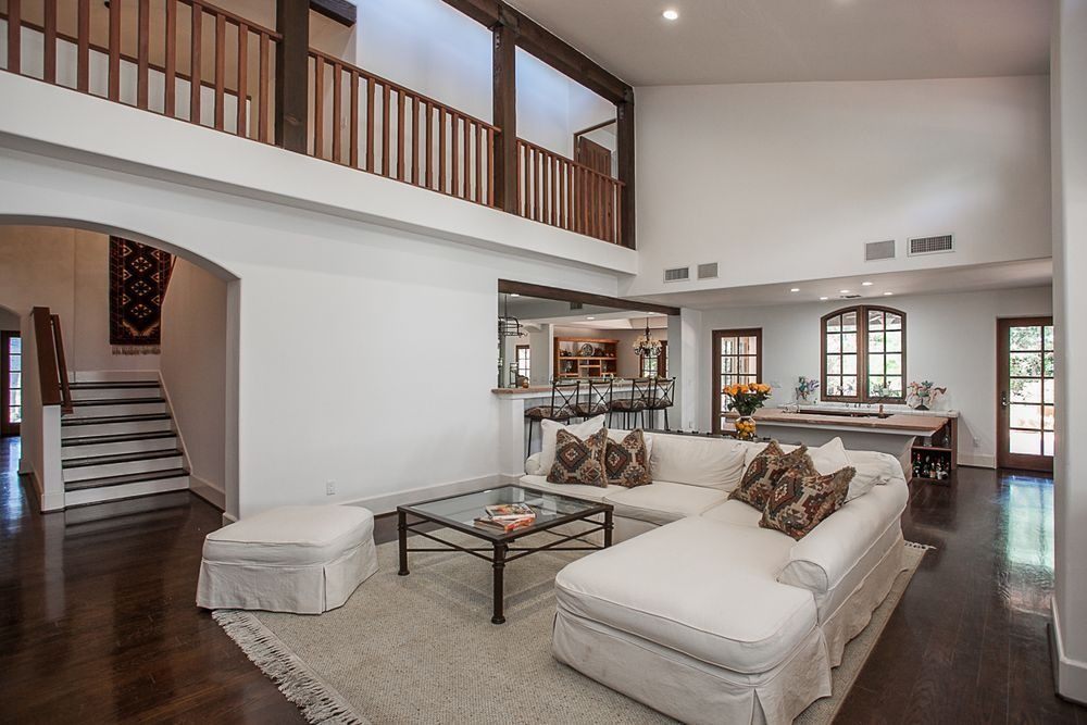 A great room featuring a living space with an L-shaped couch and a bar area. Image courtesy of Toptenrealestatedeals.com.