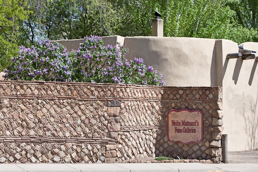 This is the main entry of the compound with a vintage stone signboard on its stone wall. Image courtesy of Toptenrealestatedeals.com.