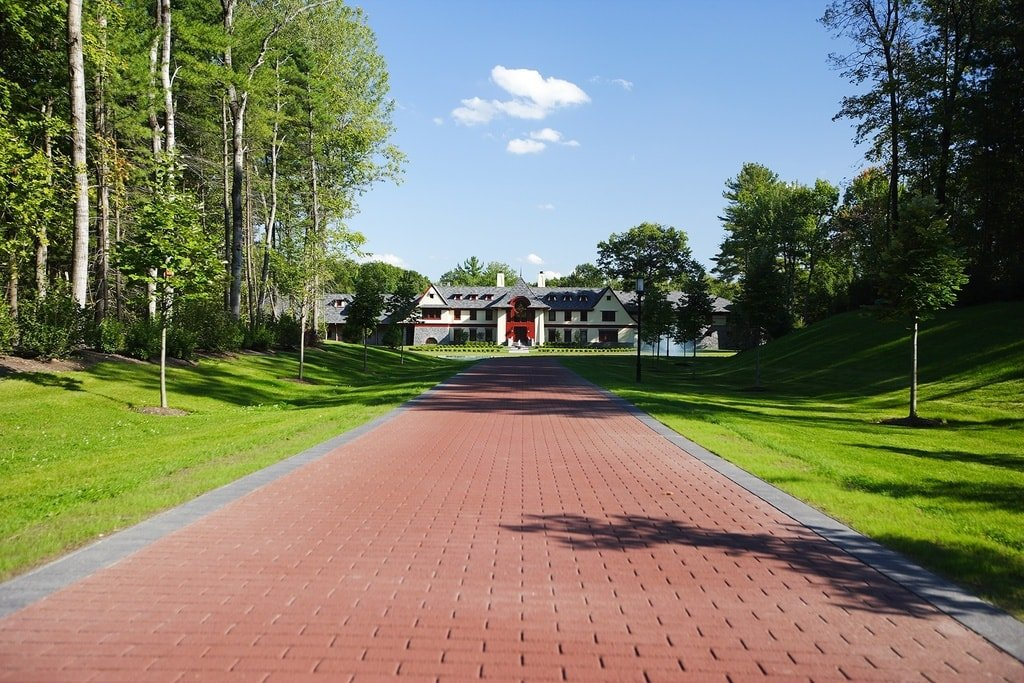 This is the driveway that leads to the front of the house. It has terracotta bricks that contrast the flanking grass lawns and tall trees. Image courtesy of Toptenrealestatedeals.com.