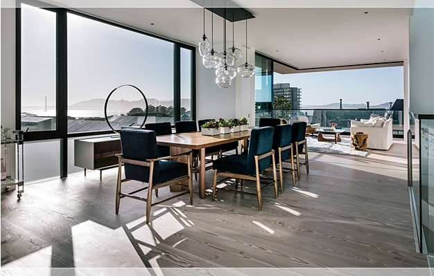 This other view of the dining area shows that it leads to the balcony on the far end. This area also has a large glass wall on the side with sweeping views. Image courtesy of Toptenrealestatedeals.com.