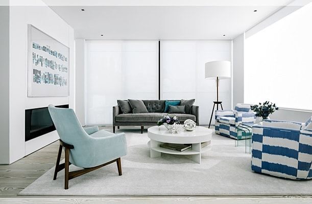 This is the bright and airy living room with white walls, ceiling and a white modern fireplace. These make the pasterl hues of the furniture stand out. Image courtesy of Toptenrealestatedeals.com.