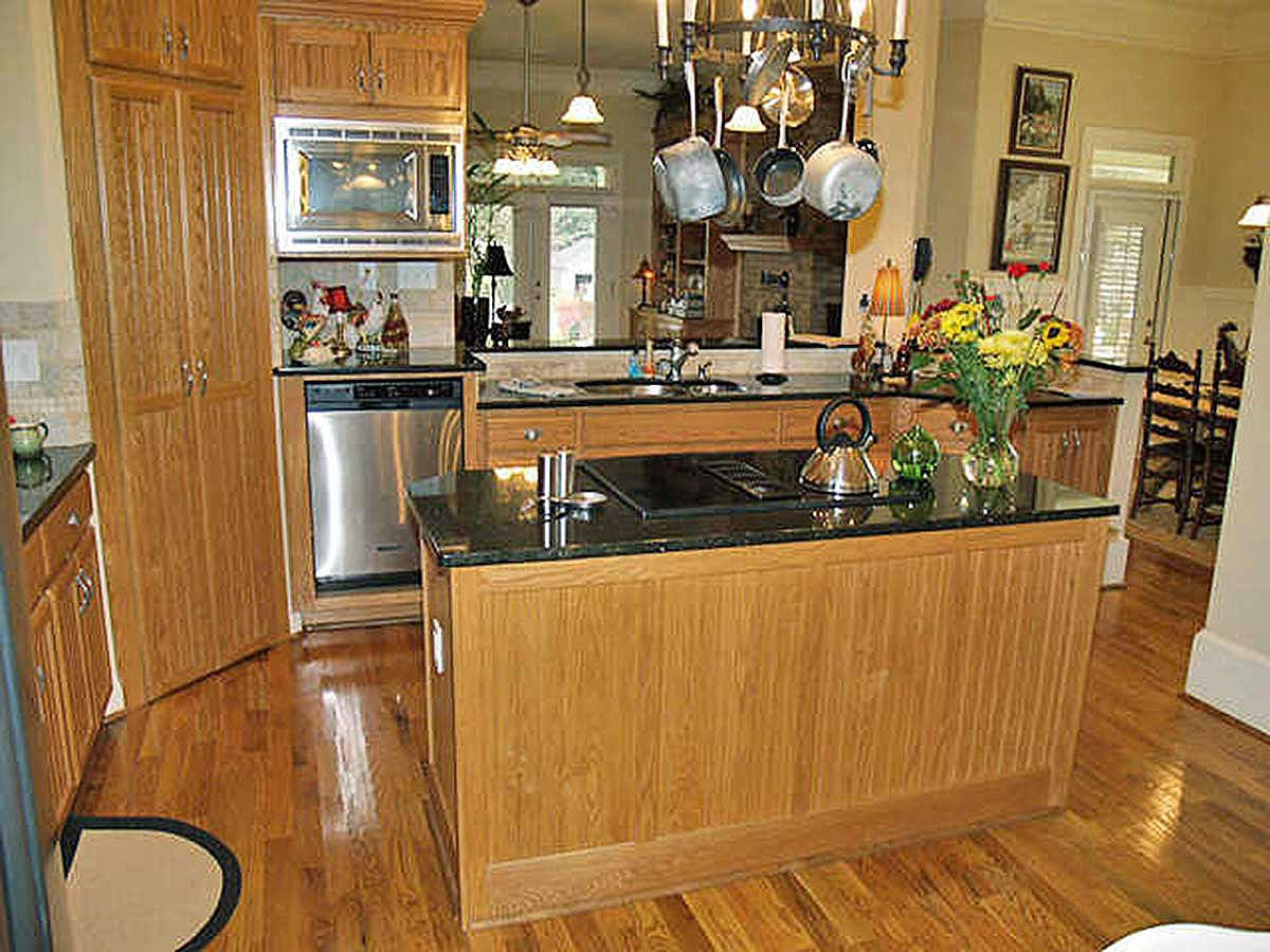 There are also stainless steel appliances and custom wood cabinets that blend in with the hardwood flooring.